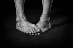 Dirty bare feet. Dirty, barefoot, funny crossed male legs Stock Photography