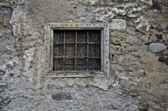 Dirty Barred Window. A old barred window in a stone wall Stock Image