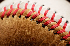 Dirty baseball against a dark background, close-up Stock Photography
