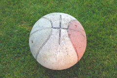 Dirty Basketball. On Grass stock photography
