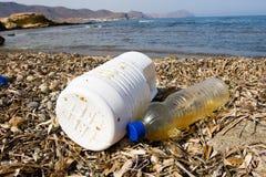 Dirty beach. Trash on beach shore Stock Images