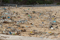 Dirty beach on the island of Little Andaman in the. Indian Ocean littered with plastic. Pollution of coastal ecosystems, natural plastic and beaches Royalty Free Stock Image