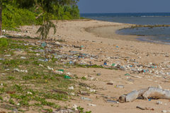 Dirty beach on the island of Little Andaman in the. Indian Ocean littered with plastic. Pollution of coastal ecosystems, natural plastic and beaches Royalty Free Stock Images