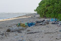 Dirty beach on the island of Little Andaman in the. Indian Ocean littered with plastic. Pollution of coastal ecosystems, natural plastic and beaches Stock Image