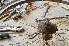 Dirty bicycle of rear sprocket wheel. Close up of a very dirty bicycle of rear sprocket wheel and hub with tools Royalty Free Stock Image