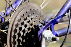 Dirty bicycle sprocket on blue bike. Royalty Free Stock Photography