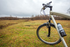 Dirty bike on the field in cloudy time Stock Photos