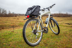 Dirty bike on the field in cloudy time Royalty Free Stock Image