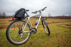 Dirty bike on the field in cloudy time Royalty Free Stock Photos