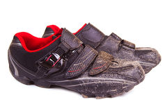 Dirty bike shoes isolated Royalty Free Stock Photography