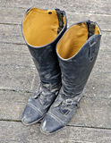 Dirty black riding boots Royalty Free Stock Image