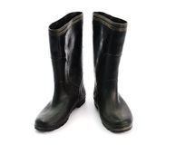 Dirty black rubber boots isolated on white background.  Royalty Free Stock Images