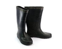 Dirty black rubber boots isolated on white background.  Stock Images
