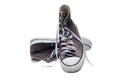 Dirty black sneakers in isolated Royalty Free Stock Image