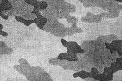 Dirty black and white old camouflage uniform pattern. Royalty Free Stock Photo