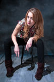 Dirty-blond sitting on stool. Beautiful dirty-blond girl sitting on stool with attitude Stock Photos