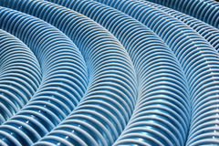Dirty blue corrugated plastic hose as background Royalty Free Stock Photography
