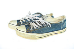 Dirty blue jean shoes Stock Images