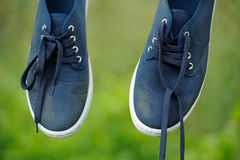Dirty Blue Sneakers on Clothes Line Stock Photography