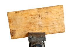 Dirty board in metal vice Royalty Free Stock Photography