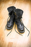 Dirty boots. On parket floor Royalty Free Stock Images