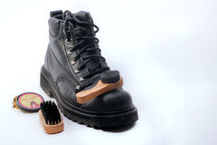 Dirty boots with shoe polish. Images of a diry boot with cleaning products Stock Photography