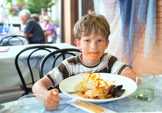 The dirty boy in italian restaurant Royalty Free Stock Photos