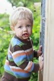 Dirty boy outdoor. Garden, summer time Stock Photo