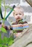 Dirty boy outdoor. Garden, summer time Royalty Free Stock Image