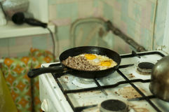 Dirty breakfast. Poor man`s breakfast: fried eggs at a dirty kithen Royalty Free Stock Photography