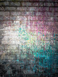 Dirty brick with spots of paint colors Stock Photography