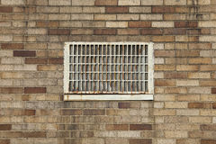 Dirty brick wall with vent Stock Photos