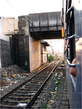 Dirty Bridge. A dirty cluttered railway track under a bridge in India Royalty Free Stock Photo