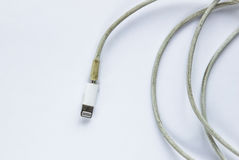 Dirty and broken charger cable.  Stock Images