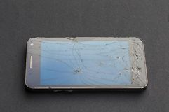 Dirty and broken smartphone. Focus on dirty and broken glass smartphone royalty free stock images