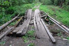 Dirty broken wooden bridge in forest Stock Photos