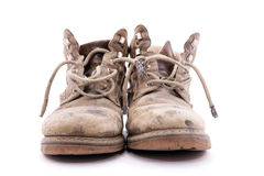 Dirty brown boots. Stock Images