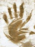 Dirty brown hand print Stock Image