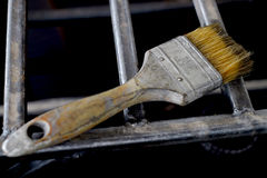 Dirty Brush. On the steel frame Stock Photography