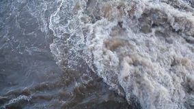 Dirty bubbling water 001. Dirty water bubbling up merging into a municipal sewer stock footage