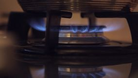 In a dirty budget kitchen with a dim light on the gas stove stock footage
