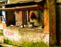 A butcher`s shop in Nepal with a goats head on the counter royalty free stock photo