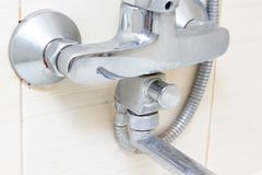Dirty calcified shower mixer tap, faucet with limescale on it, close up.  royalty free stock photography