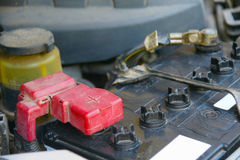 Dirty car battery with red positive polarity for auto concept. (Selective focus at positive symbol Stock Images