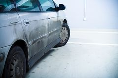 Dirty car in garage stock photography