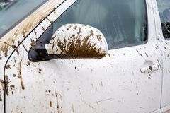 Dirty car in rural areas. Fragment of dirty car in rural areas close-up royalty free stock photo