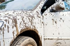 Dirty car in rural areas. Fragment of dirty car in rural areas close-up Royalty Free Stock Image