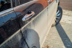 Dirty car side. Close-up image of dirty car side required to be washed Stock Photography
