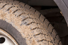 Dirty car tire Royalty Free Stock Photo