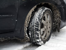 Dirty car tire with snow Royalty Free Stock Photo